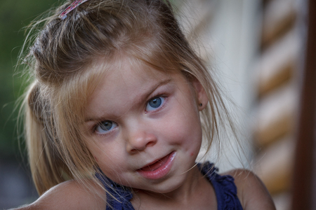 blonde blue eyes: Close up photo of a beautiful blonde blue eyes girls portrait