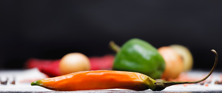 abstract food: Vegetables laying on a table with saturated colour and black background