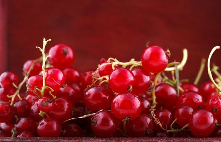 Red currant background, placed in a handmade wooden chest box