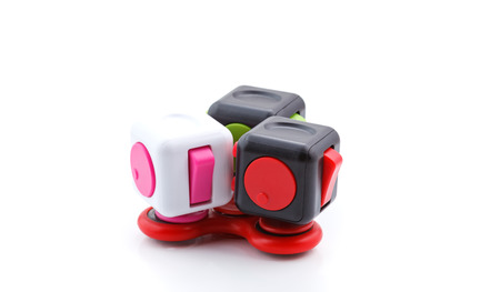 cool gadget: Anti stress and relaxation fidgets, cube and spinner for exhausted people Stock Photo