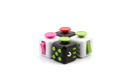 Anti stress and relaxation fidgets, cube and spinner for exhausted people Stock Photo