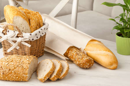 bread in a wicker basket on a light background on a table Stock Photo
