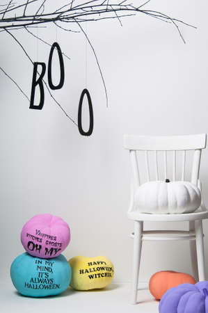 colorific: halloween pumpkins with brightly colored chair and tree on a white background