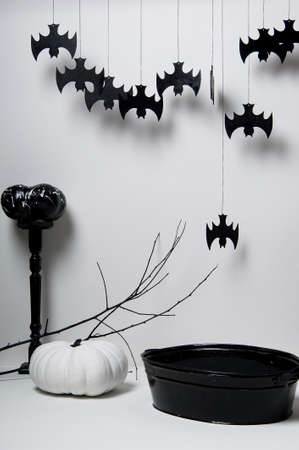 halloween with black bats and pumpkins on a white background