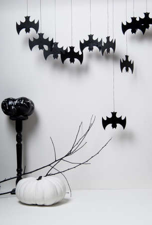 washbowl: halloween with black silhouettes of bats and pumpkins with a branch of a tree on a white background Stock Photo