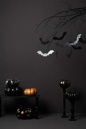 colorific: halloween with black bats on a tree and painted pumpkins on a dark background