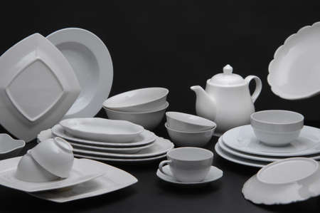 kitchen ware: large set of white kitchen ware on a black background closeup Stock Photo