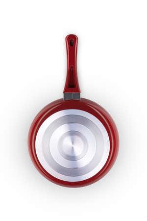Una sartén de color rojo sobre un fondo blanco de cerca Foto de archivo - 64764704