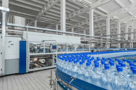 for the production of plastic bottles and bottles on a conveyor belt factory Reklamní fotografie - 66529537
