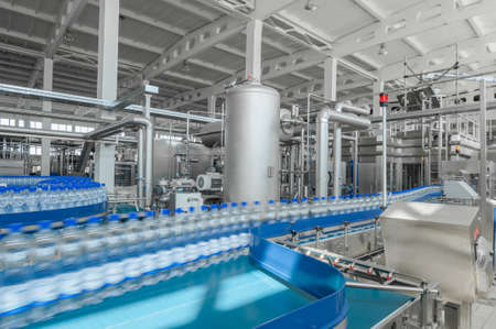 for the production of plastic bottles and bottles on a conveyor belt factory 스톡 콘텐츠