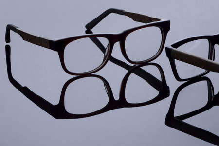 Sunglasses in a square frame on a light background with mirror reflection 스톡 콘텐츠