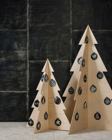 New Years and Christmas decoration fir plywood and a tree on a dark background