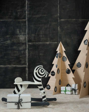 New Years and Christmas decoration zebra and fir plywood and wood on a dark background