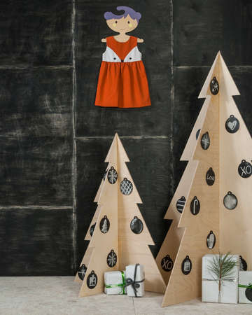 plywood: New Years and Christmas decoration fir boxes made of plywood and wood gifts on a dark background Stock Photo