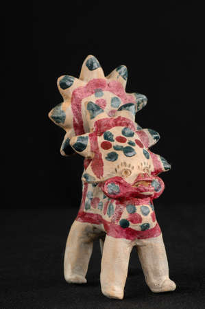 Asian and Oriental painted toy from burnt clay in the form of fantastic creatures and animals on a black background