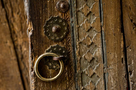 parts and elements of the old antique wooden door with a handle Stock Photo
