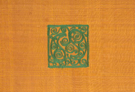 background of the fabric and textile material is gold colored with a square green pattern