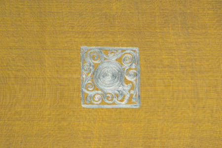 background in the form of fabric and khaki textile material with a square pattern silver
