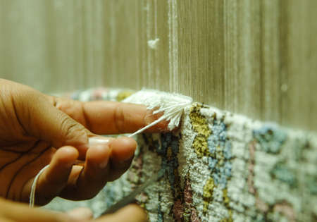 weaving and manufacturing of handmade carpets closeup 免版税图像 - 66950100