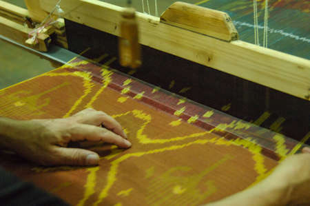 handloom: Hand made on a wooden loom manufacture of thread and fabric closeup Stock Photo