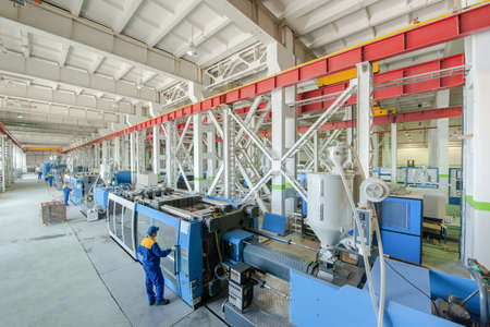Industrial injection molding press machine for the manufacture of plastic parts using polymers in the management of worker