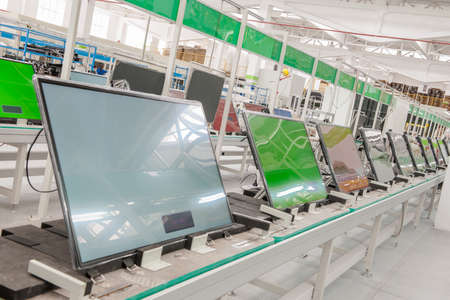 closeup line conveyor assembly and testing televisions in a workshop Stok Fotoğraf