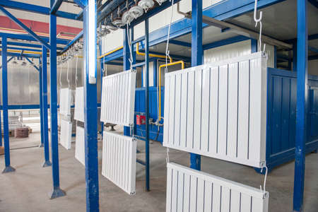 workshop for assembling and painting household heating radiators. conveyor line painting and drying of household heating radiators