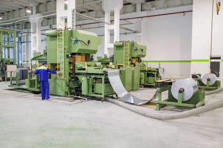 metal working: machine for cutting sheet metal in rolls. sheet metal working in rolls