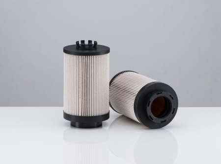 gasket: two automotive filter cylindrical shape  on a white background with reflection Stock Photo