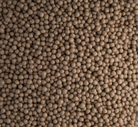 background of small plastic pellets brown colored