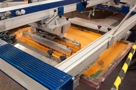 equipment and machines for painting cloth at a garment factory closeup 版權商用圖片