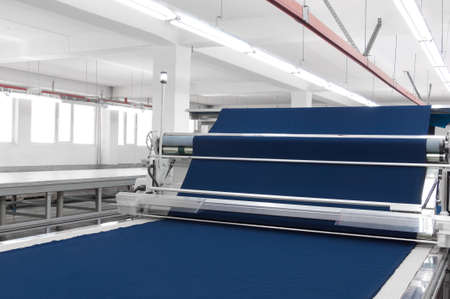 equipment for the preparation of cloth at a garment factory Stockfoto