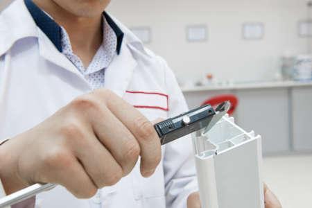 profile measurement: the laboratory technician measures the plastic profile with a digital caliper. the worker conducts measurements with a digital caliper
