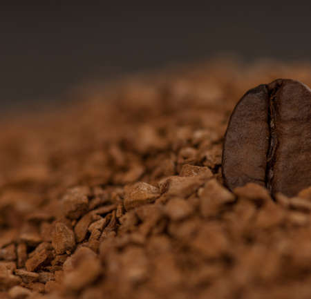 one coffee bean in granulated coffee Stock Photo