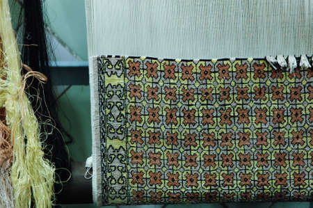 oriental rug: weaving and manufacturing of handmade carpets closeup. carpet in the making process