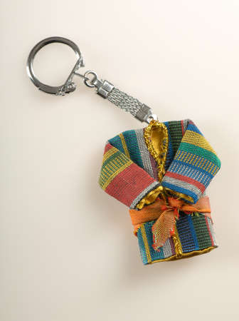 keychain in the form of national Oriental clothing on white background