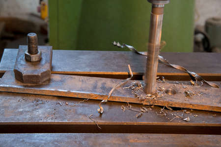 Drilling of the metal plate, close up