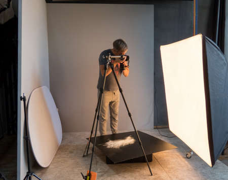 photographer working in the studio. unintended photography Stock Photo