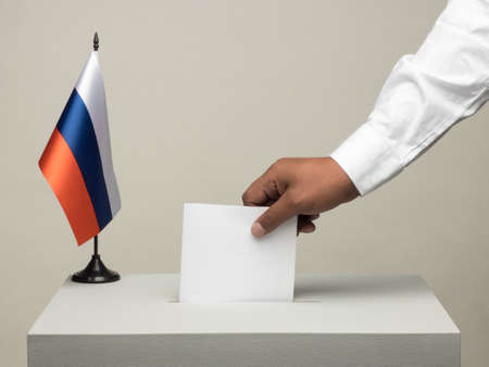 Ballot box with national flag of Russia. Presidential election in 2018. hand throwing a ballot Stock Photo