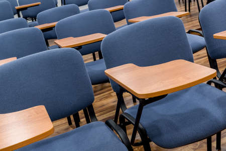 Chair and table in the empty lecture and training class. Close up. classroom Stok Fotoğraf