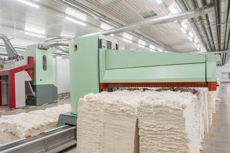 carding machine in spinning workshop. equipment and technologies at the textile factory