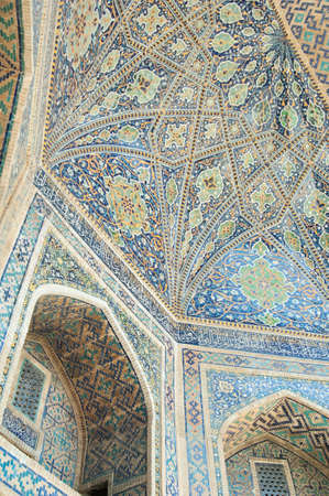 The ceiling is carved with ancient Asian ornament. the details of the architecture of medieval Central Asia