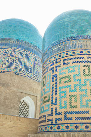 Domes and towers of Registan in Samarkand. Ancient architecture of Central Asia
