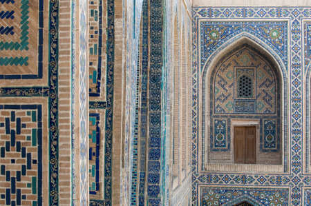 The arch and the exterior design of the ancient Registan in Samarkand. Ancient architecture of Central Asia