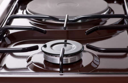 the top of the modern electric-gas stove, close-up of the heating panel