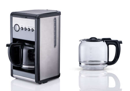 modern electric coffee maker and glass container on white background with reflection, insulated. kitchen accessories
