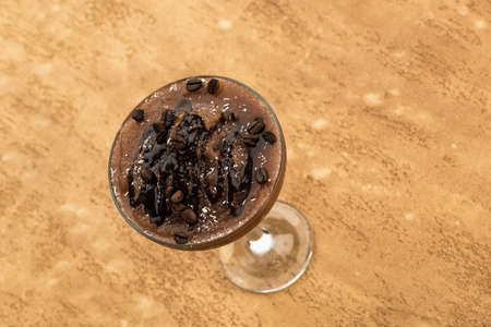 Chocolate smoothie on a light brown background