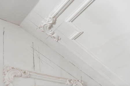 unfinished plaster molding on the ceiling. decorative gypsum finish. plasterboard and painting works Stock Photo