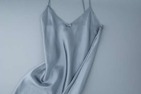female nightgown on a gray background, isolated, top view
