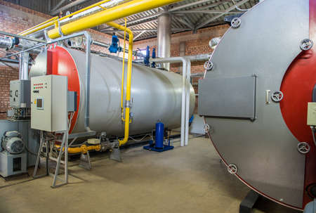 modern industrial boiler room with compressor equipment. control panel